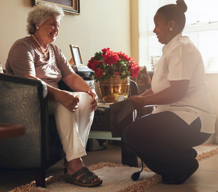 caretaker taking care of elderly patient