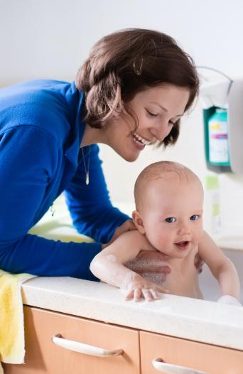 caregiver bathing baby