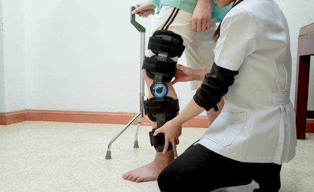 caretaker taking care of rehab patient